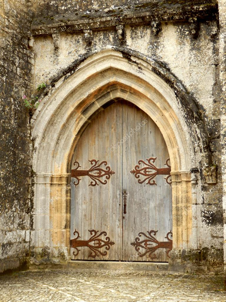 Medieval Arched Double Doors \u2014 Stock Photo & Medieval Arched Double Doors \u2014 Stock Photo © PlazacCameraman #26804319