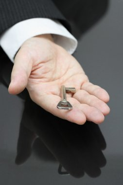 businessman holding the key to success