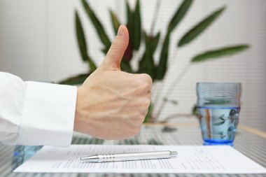Thumbs up gesture over signed application