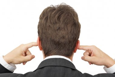 businessman blocking his ears with fingers .