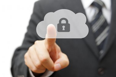Safe cloud and online remote data. businessman pressing cloud ic
