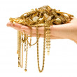 stock-photo-hand-holding-expensive-gold-jewelry