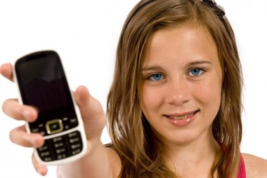 Teenager With Cell Phone Close Up Face In Focus