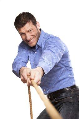 Man pulling rope