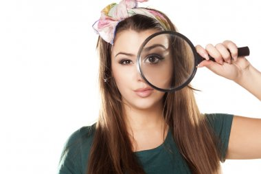 Nice and beautiful girl looking through a magnifying glass stock vector