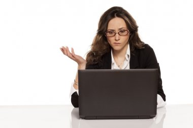 confused girl with a laptop