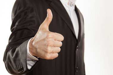 Close up of strong male hand of businessman showing thumbs up on white background stock vector