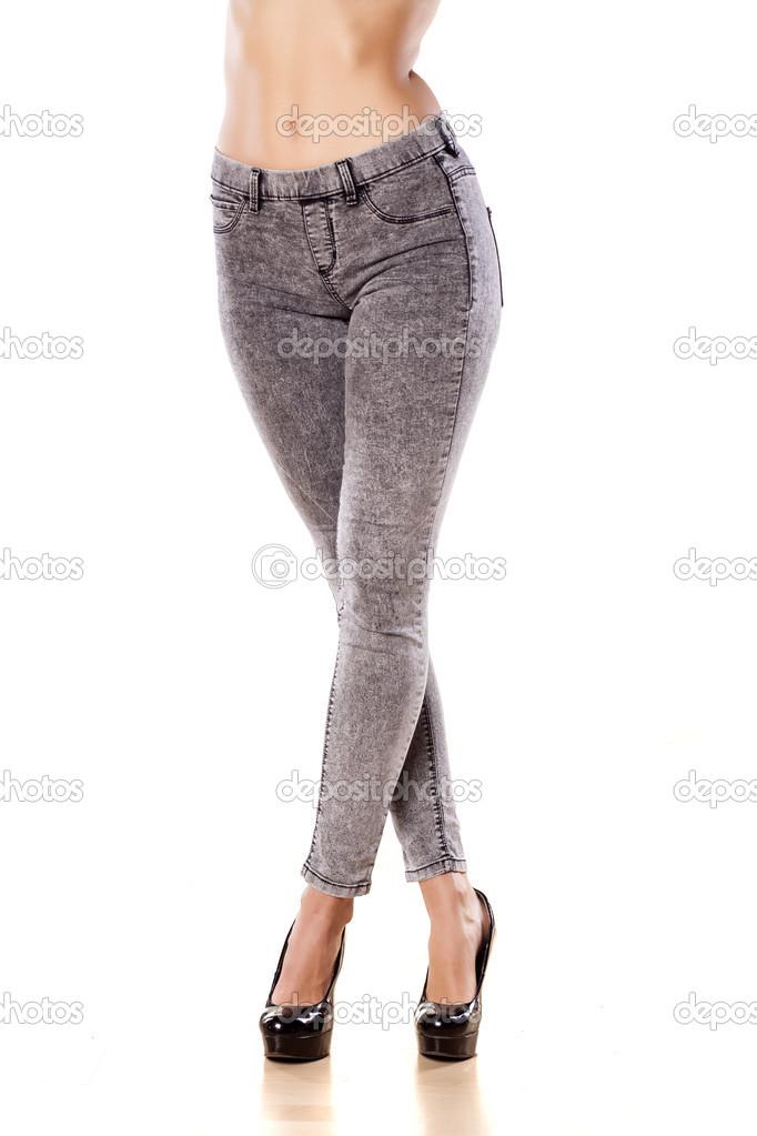 17144d576786 Στενό τζιν — Φωτογραφία Αρχείου · Pretty female legs in tight jeans on  white background — Εικόνα από VGeorgiev