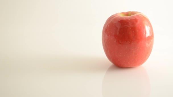 Rotating Pink Lady Apple On Acrylic Against White - Crane Up
