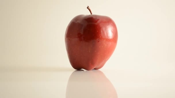 Rotating Red Delicious Apple On Acrylic Against White - Dolly Right
