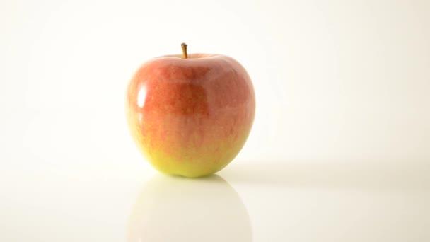 Rotating Braeburn Apple On Acrylic Against White - Dolly Left