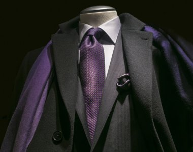 Black coat, black jacket, purple tie & scarf