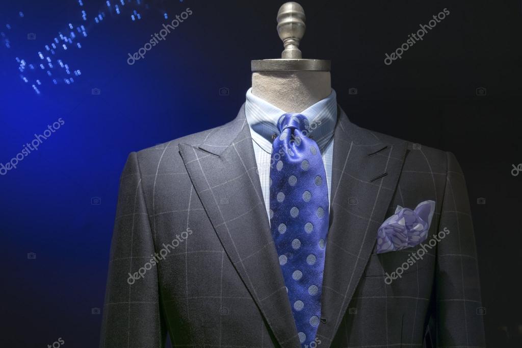 Giacca a scacchi grigio con camicia a scacchi, cravatta blu
