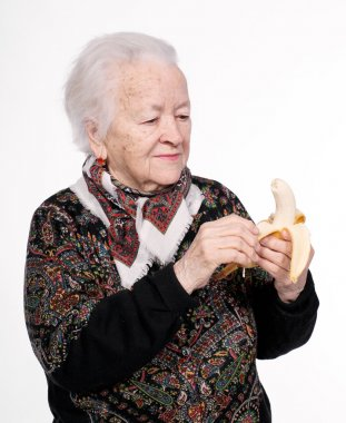 Old woman with banana