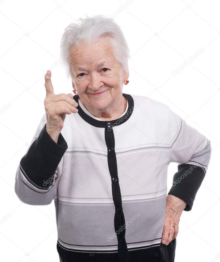 Portrait Of A Happy Old Woman Pointing Upwards
