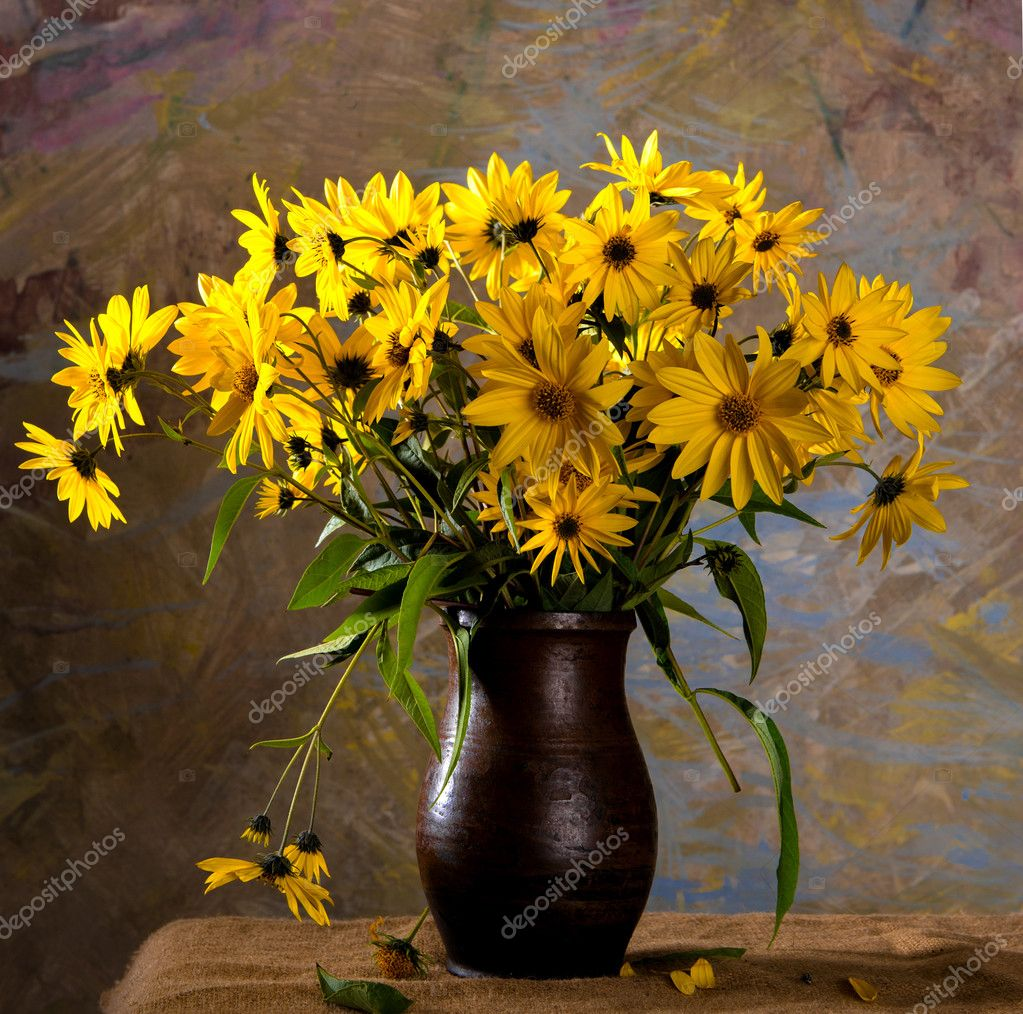 Still life with bunch of bright yellow flowers (rudbeckia)