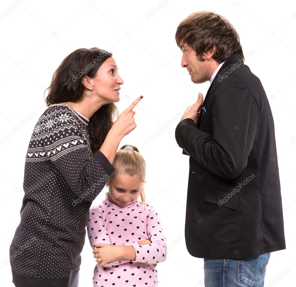 Sad looking girl with her fighting parents