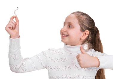 Girl holding dental braces