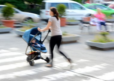 Mother with toddler son in stroller