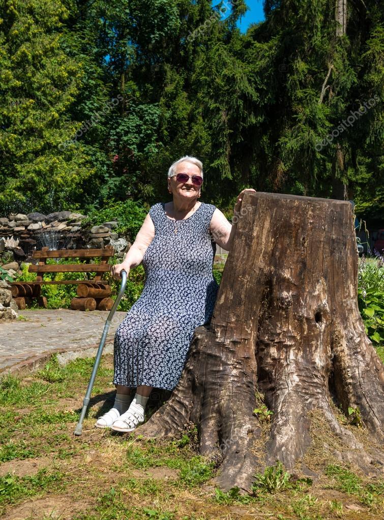 Old Woman Sitting On A Bench Stock Photo 169 Vbaleha 50421559