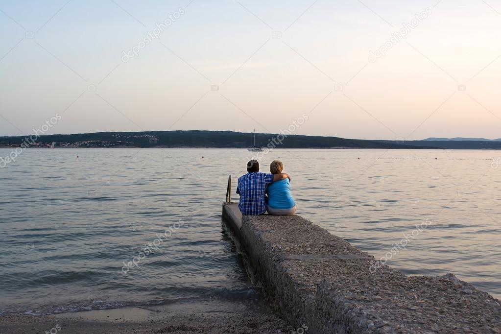 Senior couple enjoying romantic evening on the beach