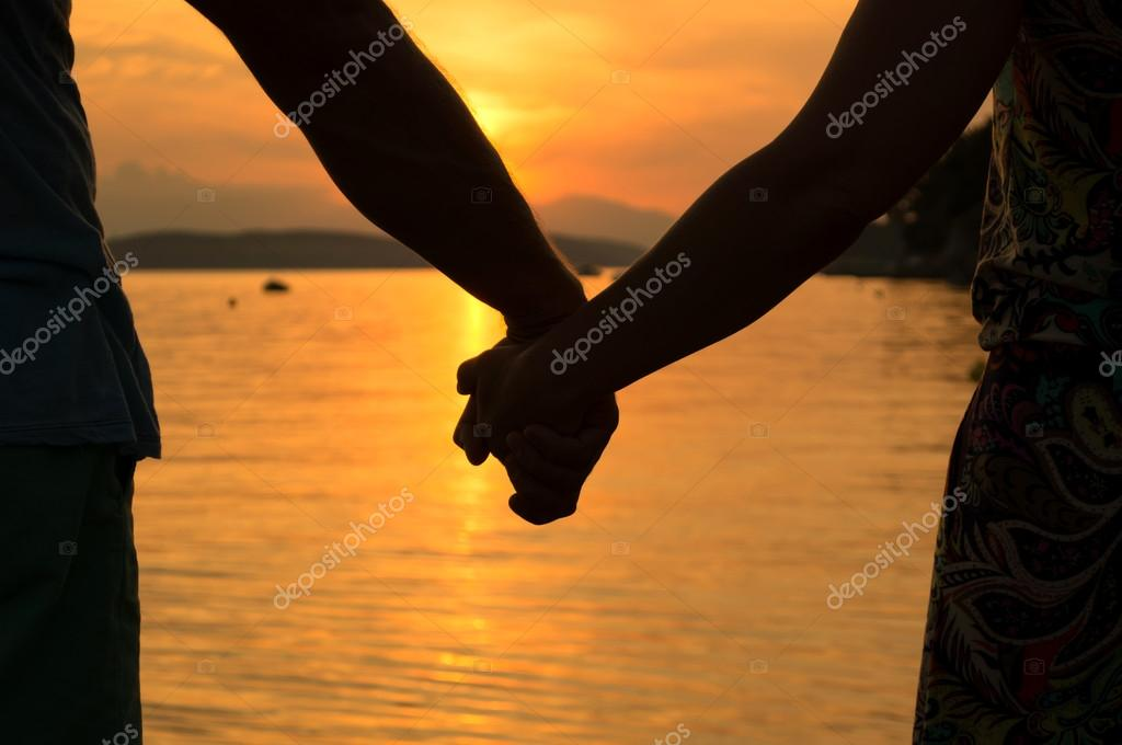 Romantic couple holding hands
