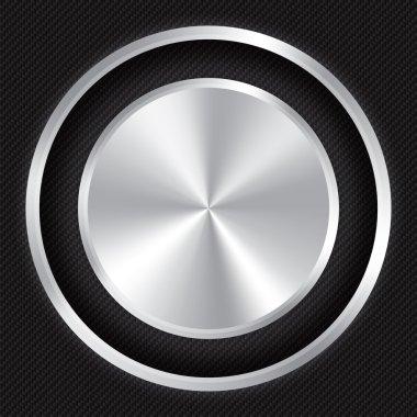 Metallic button on Carbon fiber background.