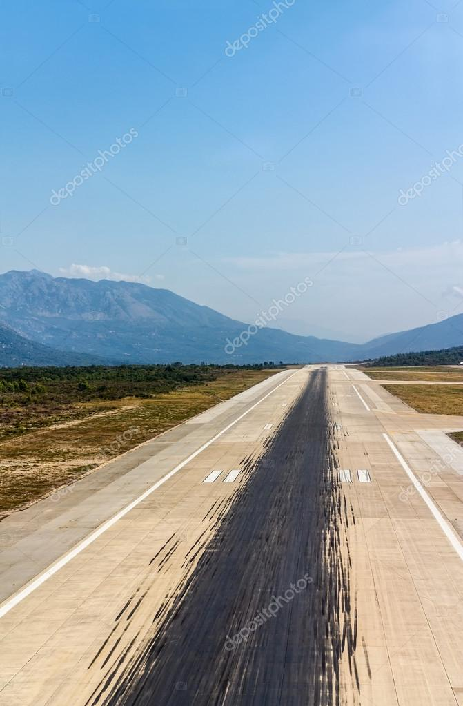 Aircraft tire tracks at airport runway