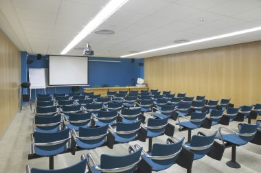 Conference room interior with projector and screen