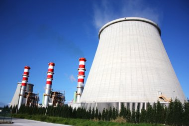 Power plant chimneys producing white smoke against a blue sky stock vector