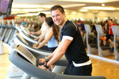 Man on treadmill smiling