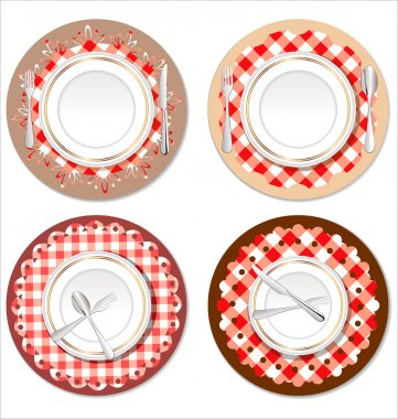 White plate on a checkered red tablecloth