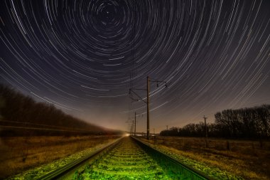 Night rails -green way with motion stars, stratrails skyes