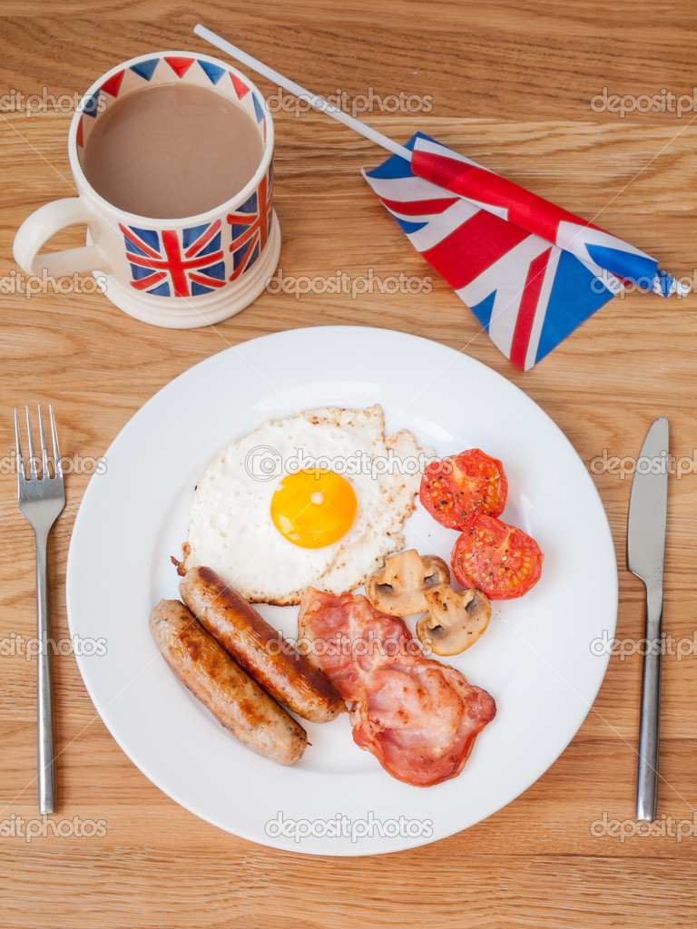 full english breakfast with cup of tea and british flag. Black Bedroom Furniture Sets. Home Design Ideas
