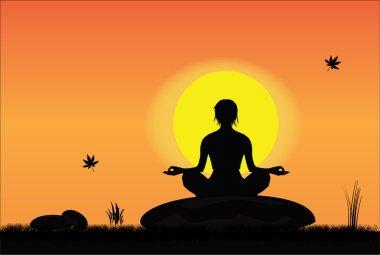 Woman meditating on a rock
