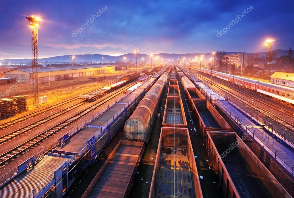 Cargo train platform at night - Freight trasportation