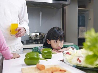 Little girl in kitchen