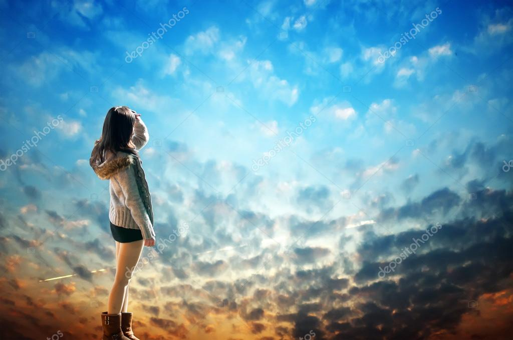 Beautiful Young Girl Looking Up At The Sky Stock Photo C Gjp1991 22485933