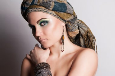 Turkish woman in a turban. Fashion.