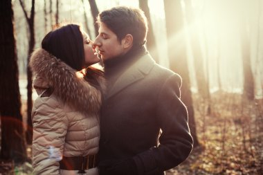 Sensual outdoor portrait of young couple in love