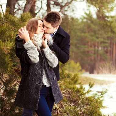 Couple in love in the cold spring forest