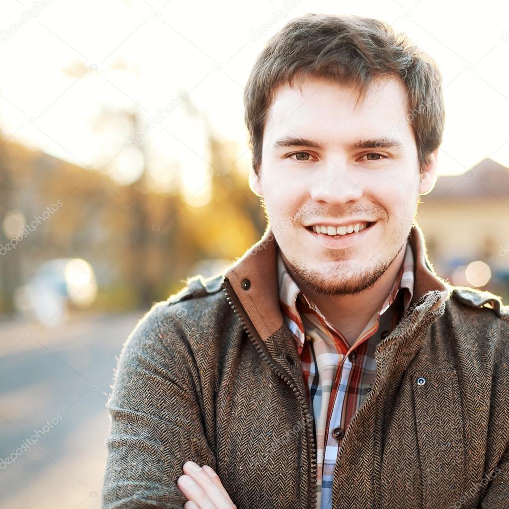 Handsome man outdoors portrait.