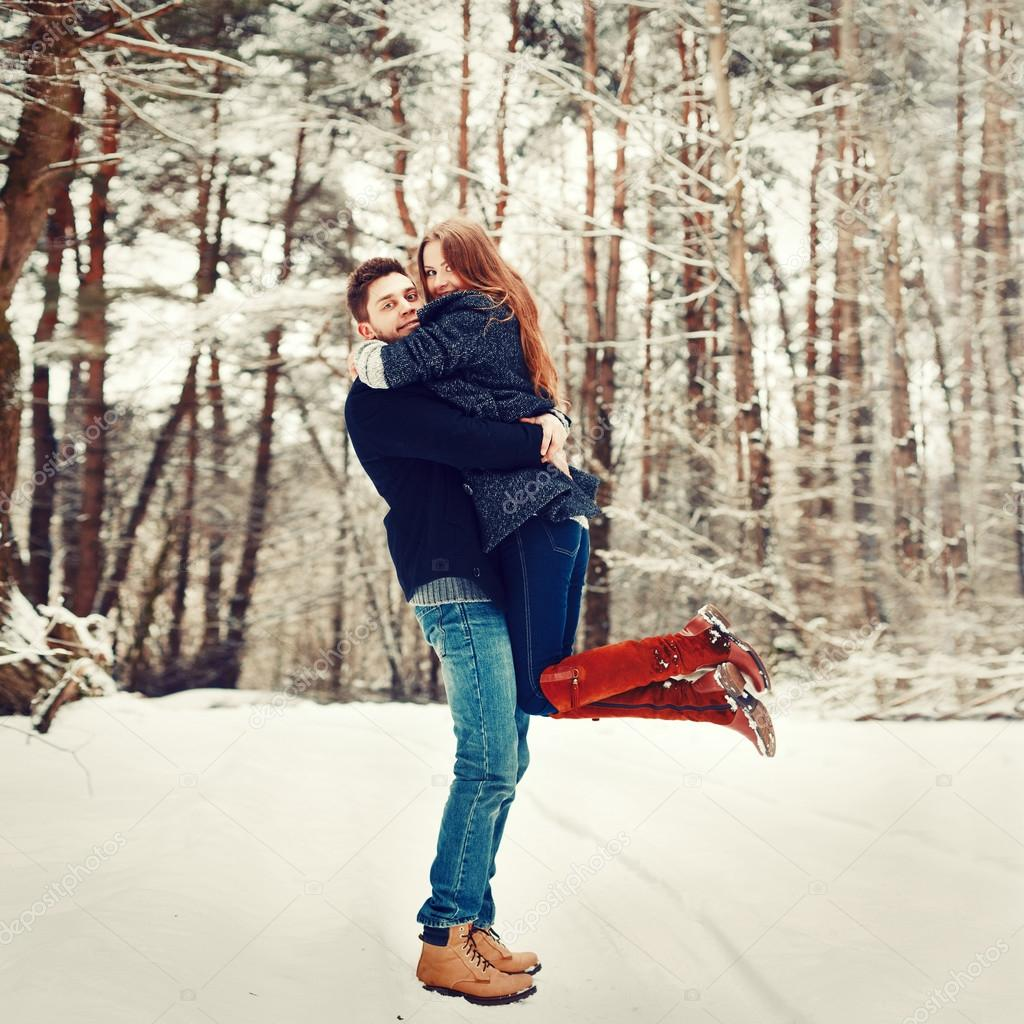 Young couple having fun outdoor in winter