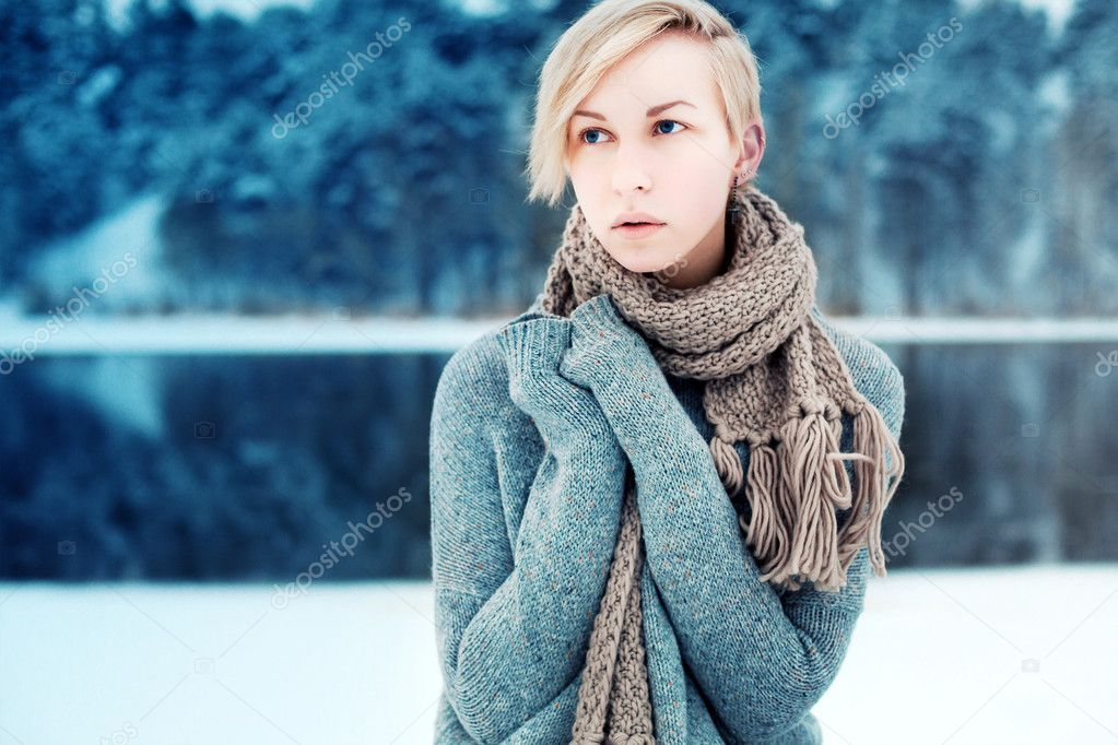 serious sensual woman in winter forest