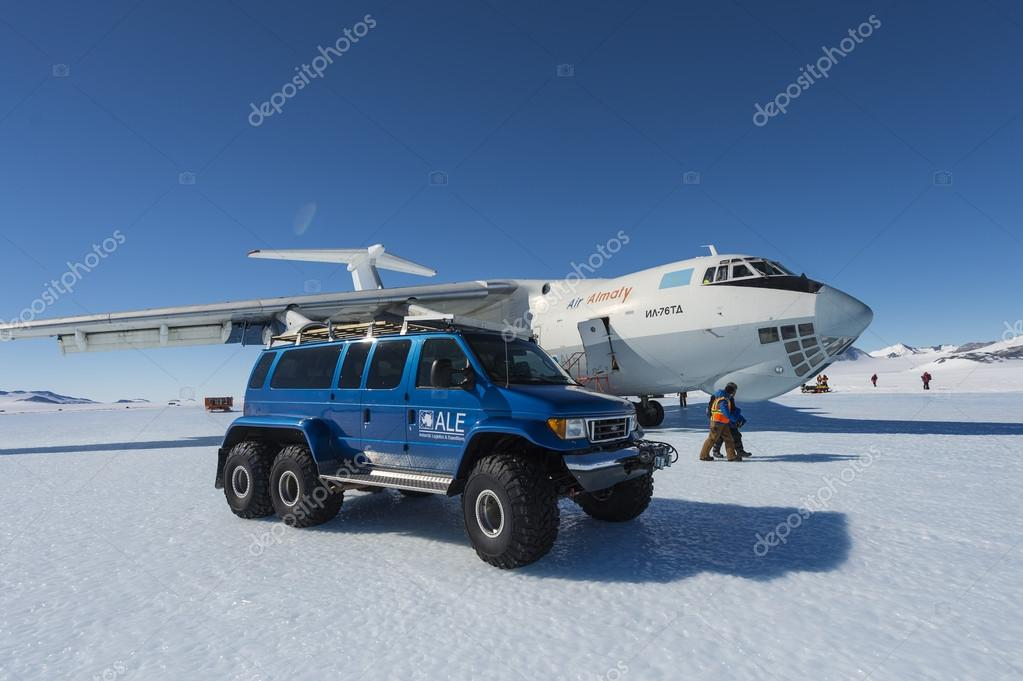 SUV car and airplane at the South Polar airfield, Antarctica