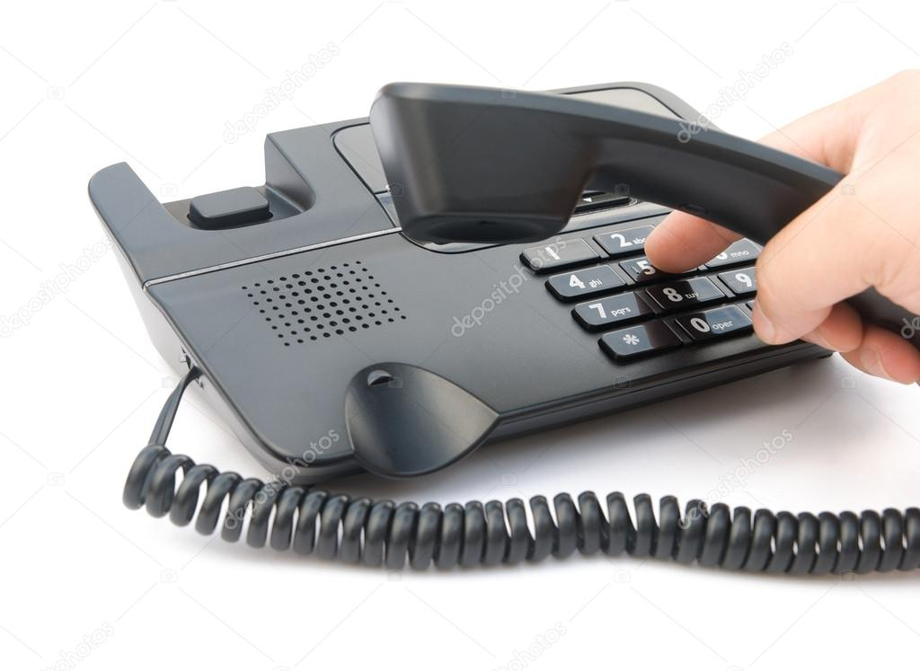 Man dialing a telephone with clipping path