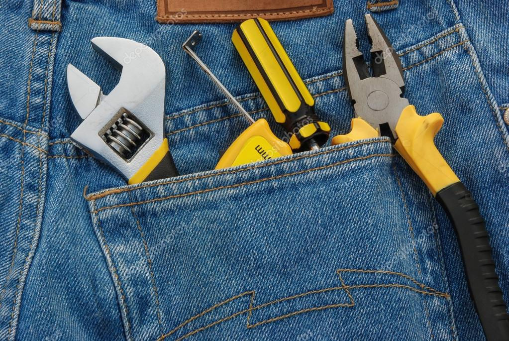 Tools in a blue jean back pocket