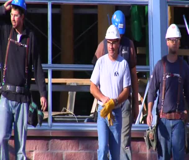 Construction workers walked toward camera slow motion
