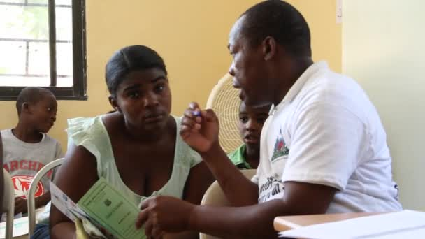 Doctor instructs woman in the Haitian clinic