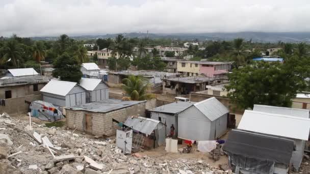 Pan over earthquake damaged neighborhoods Port-au-Prince Haiti